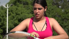Angry Athletic Female Teenage Tennis Player. A young female hispanic teen stock footage
