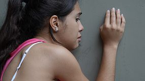 Diverse Girl And Loneliness. A young female hispanic teen Stock Photos