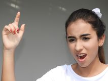 Mad Latina Teenage Female. A young female hispanic teen royalty free stock images