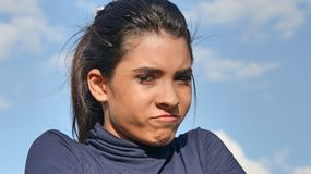 Pretty Female And Anger. A young female hispanic teen Stock Photo