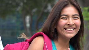 Pretty Girl And Confusion. A young female hispanic teen stock video footage