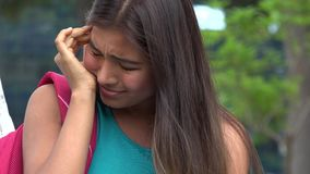 Pretty Girl And Confusion. A young female hispanic teen stock footage