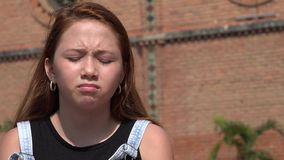 Sad Girl Feeling Agitated. A young female hispanic teen Royalty Free Stock Image