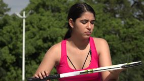 Serious Athletic Female Teenage Tennis Player. A young female hispanic teen stock footage