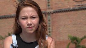 Smug Girl Smirking Stock Photography