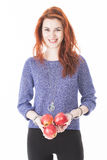 Young female hold three red apples Royalty Free Stock Images