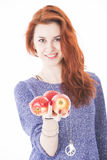 Young female hold three red apples Stock Photo