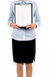 Young female holding blank clipboard. Stock Photo