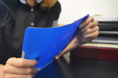Young female holding a file. An office caption of a young female holding a file and dressed in office clothing Royalty Free Stock Photo