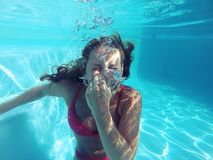Young female holding her breath underwater Royalty Free Stock Photo
