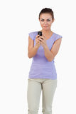 Young female holding her cellphone Stock Photo
