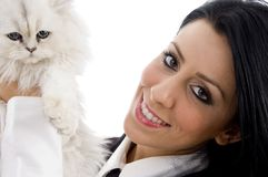 Young female holding her lovable cat Royalty Free Stock Images