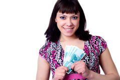 Young female holding money. Beautiful young female holding money on a white background Stock Images