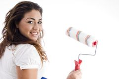 Young female holding paint roller Royalty Free Stock Photos