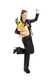 Young female holding a paper bag with groceries Royalty Free Stock Photos