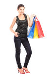 Young female holding shopping bags Royalty Free Stock Photography