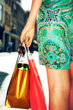 Young female holding shopping bags Stock Photos