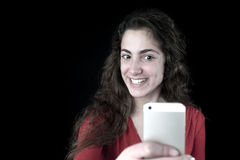 Young female holding a smartphone Royalty Free Stock Image