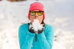 Young female holding snow Stock Photo