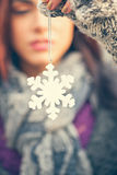 Young Female Holding Snowflake Decoration Stock Photography