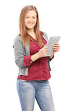 Young female holding a tablet and looking at camera Stock Images