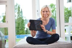 Young female holding tablet pc Royalty Free Stock Photos