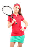 A young female holding a tennis racket Stock Photo