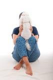 Young female holding white fluffy dog Royalty Free Stock Image