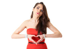 Young female holds hands in heart shape, isolated. Young attractive woman in romantic mood, heart shaped hands, isolated on white stock images