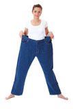 Young female holds her old huge jeans, diet Stock Image