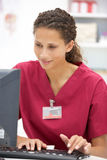 Young female hospital doctor at desk Stock Photo