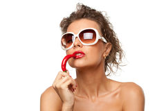 Young female with hot chili pepper Stock Photos