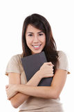 Young female hug her book Royalty Free Stock Photo