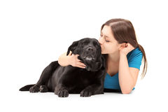 Young female hugging and kissing her dog Stock Photography