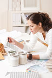 Young female interior designer with paint Royalty Free Stock Photo