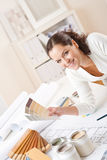 Young female interior designer with paint Stock Photo