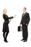 Young female interviewer talking to male businessman Royalty Free Stock Image