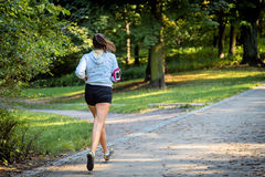 Young female jogger Stock Images