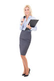 Young female journalist with microphone and clipboard isolated o Stock Photo
