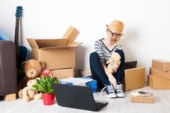 Young female just moved in a new house. Mortgage and loan concept Stock Images