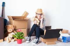 Young female just moved in a new house. Mortgage and loan concept Stock Photos