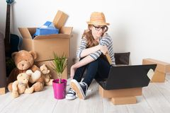 Young female just moved in a new house. Mortgage and loan concept Stock Photo