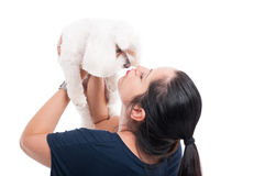 Young female kissing her dog Stock Images