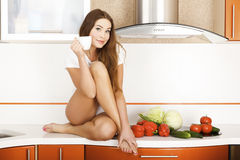 Young female in the kitchen. Stock Photos