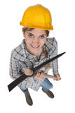 Young female laborer. Holding a pickaxe Stock Image