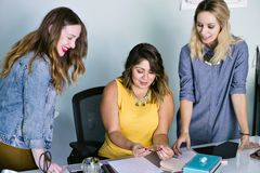 Young Female Latina Business Owner Meeting with Employees stock image
