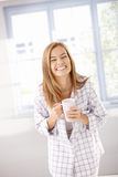 Young female laughing happily in pyjama stock photos