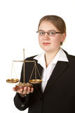 Young female lawyer. Young female business lawyer with scales isolated on white background royalty free stock image
