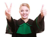 Young female lawyer attorney wearing classic polish black green gown Royalty Free Stock Image