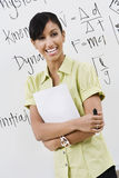 Young Female Lecturer With Arms Crossed Royalty Free Stock Images